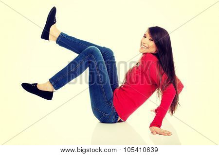 Laughing student woman with legs up on the floor.