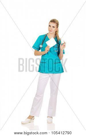 Female nurse holding gauze and hydrogen peroxide.