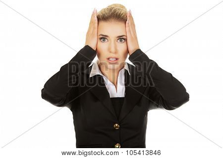 Young shocked businesswoman  olding her head in amazement and open-mouthed.