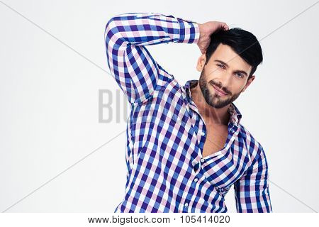 Portrait of a handsome macho looking at camera isolated on a white background