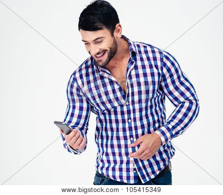 Portrait of a smiling casual man using smartphone isolated on a white background
