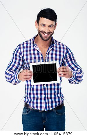 Portrait of a smiling man showing tablet computer screen isolated on a white background