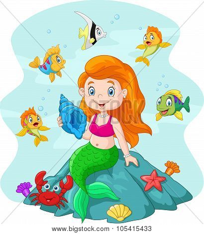 Happy little mermaid holding seashell the rock surrounded by fishes