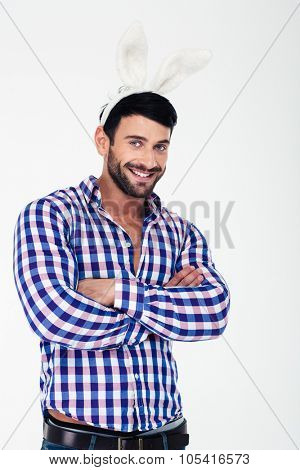 Portrait of a happy man in bunny ears looking at camera isolated on a white background