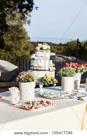 Wedding Cake In A Sweet Table.