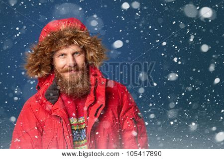 Handsome man in winter snow