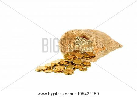 Coins Pour Out Of Bag On White Background