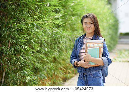 Schoolgirl in bamboo garden