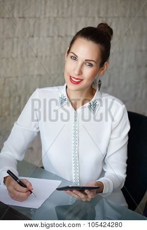 Businesswoman Write On Blank Paper And Holding Tablet