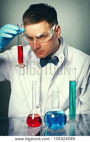 Scientist in protective glasses at laboratory