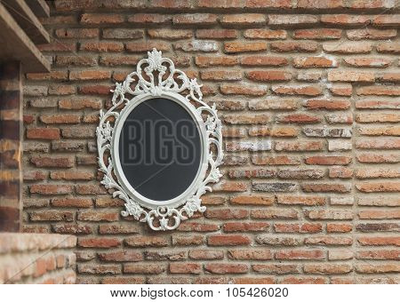 The mirror on the old brick wall