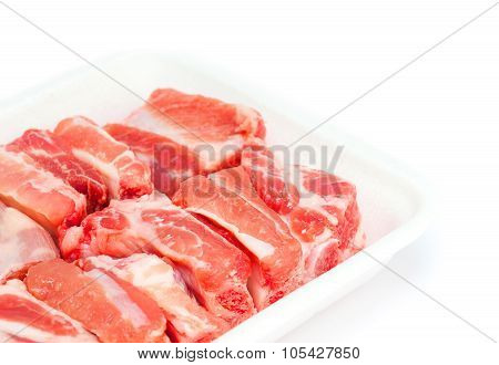 pork spareribs raw in tray foam isolated on white background