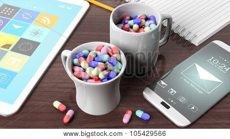 Coffee mugs full of pills, tablet, smartphone and notebook, on wooden desktop.