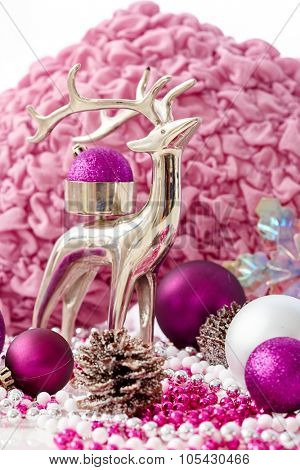 Christmas decoration in rose and violet colour with reindeer and ornaments.