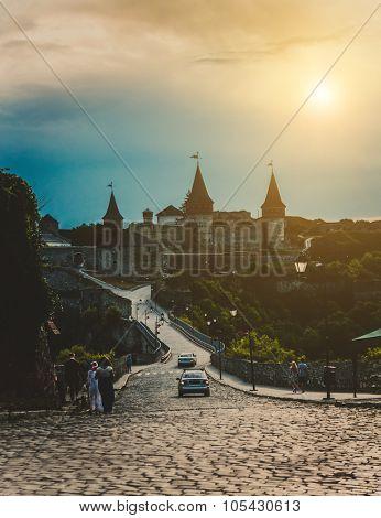 Beautiful castle on a mountain hill at sunset. Kamenetz-Podolsk, Ukraine