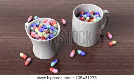 Coffee mugs full of pills,on wooden desktop.