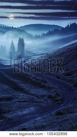 Curve Road To Mountain Forest In Fog At Night