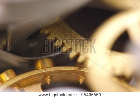 Metal Cogwheels Inside Clockwork. Macro