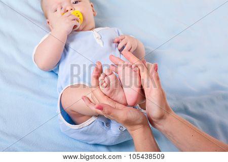 Baby's Feet In Mother's Hands