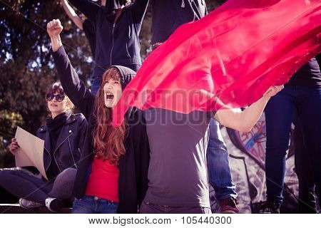 Demonstrators With Red Flag