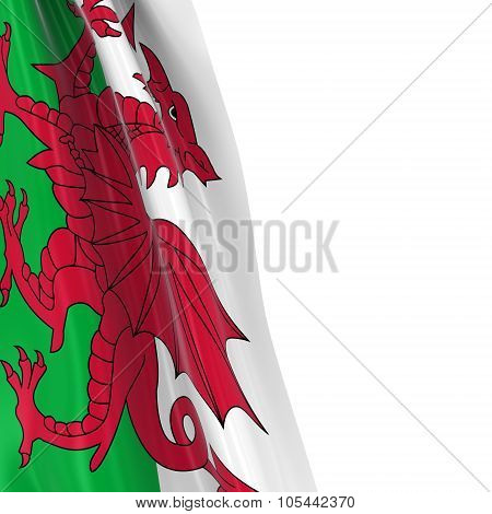 Hanging Flag Of Wales - 3D Render Of The Welsh Flag Draped Over White Background With Copyspace For