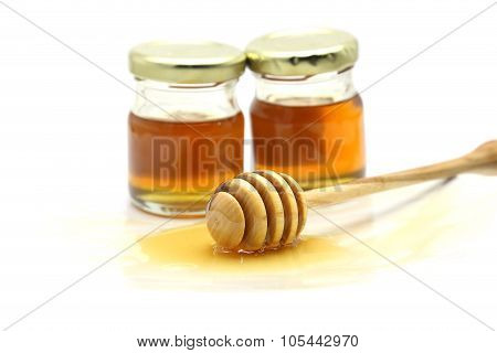 Honey And Dipper On White Background