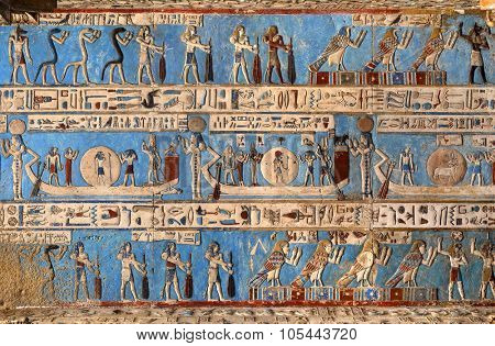 DENDERA, EGYPT - DECEMBER 05, 2014: Hieroglyphic carvings and paintings on the interior walls of an ancient egyptian temple in Dendera
