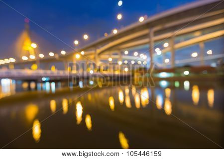Abstract blurred bokeh, city highway with suspension bridge