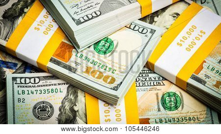 Creative business finance making money concept - panoramic bacgkround of new 100 US dollars 2013 edition banknotes (bills) bundles close up