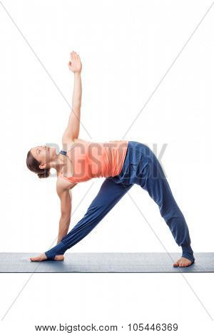 Beautiful sporty fit yogini woman practices yoga asana utthita trikonasana - extended triangle pose isolated on white background