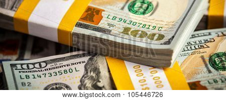Creative business finance making money concept -  letterbox panoramic background of new 100 US dollars 2013 edition banknotes (bills) bundles close up