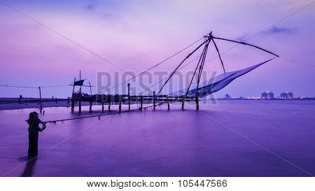 Panorama of tourist attraction of Kochi - chinese fishnets on sunset. Fort Kochin, Kochi, Kerala, India