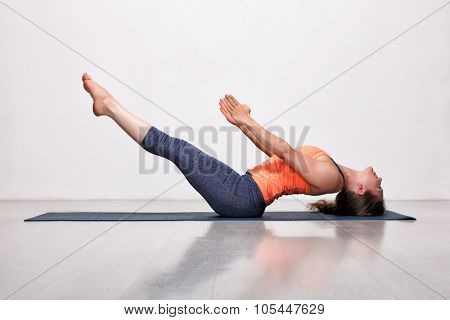 Beautiful sporty fit yogini woman practices yoga asana Uttana padasana - raised legs pose