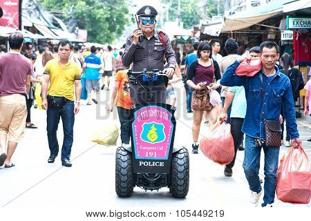 BANGKOK THAILAND -OCTOBER 18 Chatuchak Weekend Market Police tourists check out the safety of touris