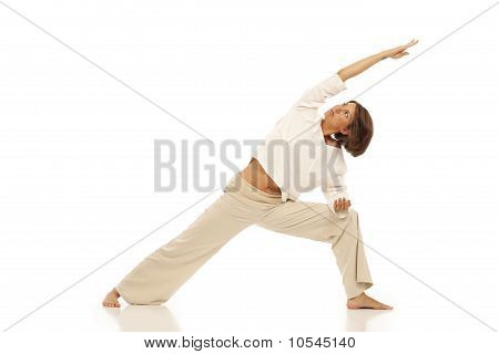Young woman doing yoga Side Angle Pose