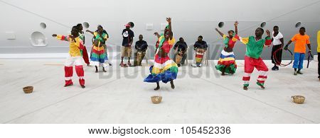 FALMOUTH, JAMAICA - SEPTEMBER 27, 2015: Dancers greet guests from the Royal Caribbean Cruise. September 27, 2015 in Falmouth, Jamaica