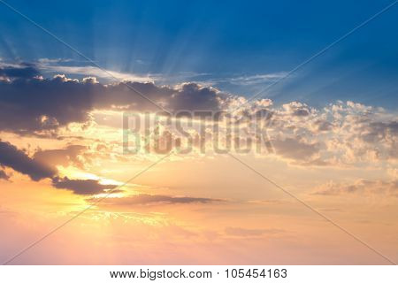Amazing Sundown Sky with Real Golden Sunbeams, natural colorful background for wallpaper