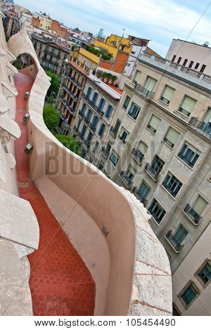 BARCELONA, SPAIN - MAY 02: Curved Walkway on Rooftop of Historic Casa Mila, Designed by Antoni Gaudi and a Popular Tourist Destination in Barcelona, Spain. May 02, 2015