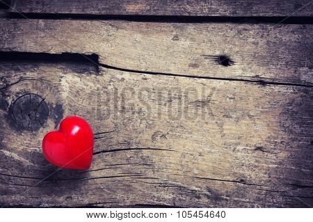 Red Heart On Aged Wooden Background.