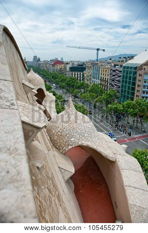 BARCELONA, SPAIN - MAY 02: View of Cityscape and Road from Rooftop of Casa Mila, Barcelona, Spain on Cloudy Overcast Day. May 02, 2015