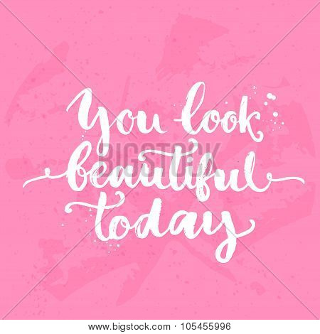 You look beautiful today. Inspirational quote, white brush calligraphy handwritten on pink backgroun