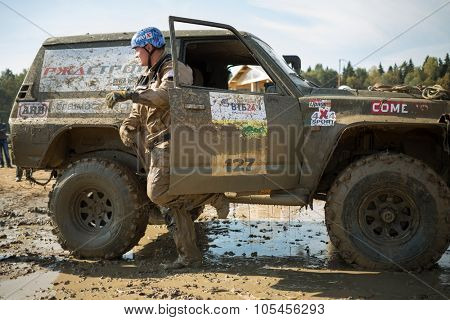 RUSSIA, PUSHKINO -?? 20 SEP, 2014: Driver is going out from off-road vehicle at Rainforest Challenge Russia Autumn 2014 PRO-X.