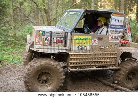 RUSSIA, PUSHKINO - 20 SEP, 2014: Sportsman is driving off-road vehicle at Rainforest Challenge Russia Autumn 2014 PRO-X.