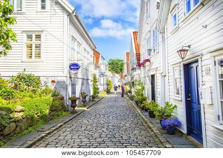 Street with white wooden houses in old centre of Stavanger.