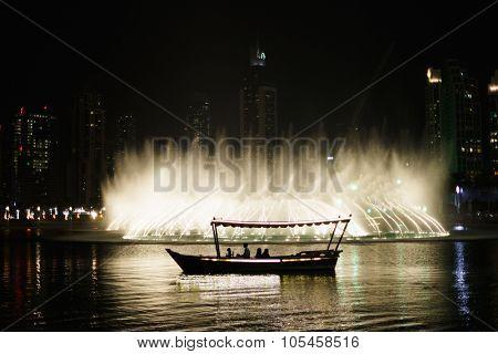 DUBAI, UAE - OCTOBER 15, 2014: The Dubai Fountain at night. The Dubai Fountain is the world's largest choreographed fountain system set on the 30-acre manmade Burj Khalifa Lake.