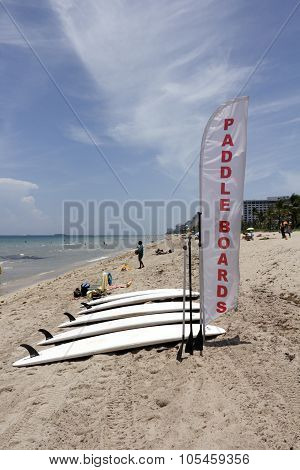 Paddle Boards And Banner Sign On The Beach