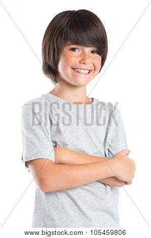 Portrait of a little boy standing with armcrossed. Studio portrait of happy male kid looking at camera. Smiling cute child with grey t-shirt laughing isolated on white background.