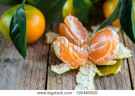 Juicy ripe tangerines with leaves on the table. Mandarin.  Shallow depth of field