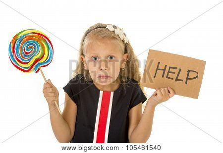 Pretty Little Child Holding Lollipop And Help Sign In Children Sugar Excess And Sweet Diet Abuse Unh