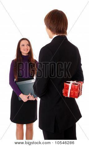Teen Boy Giving A Gift To A Girl